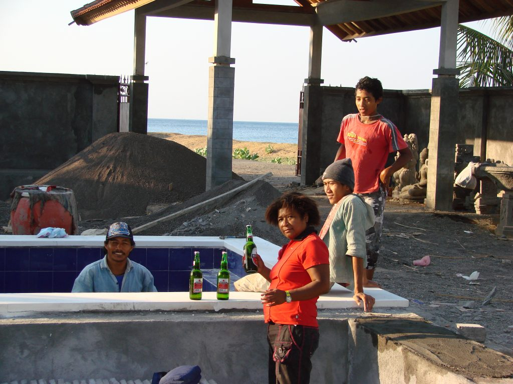 Mary Afdan drinking beer with the workmen at Villa Sinar Cinta