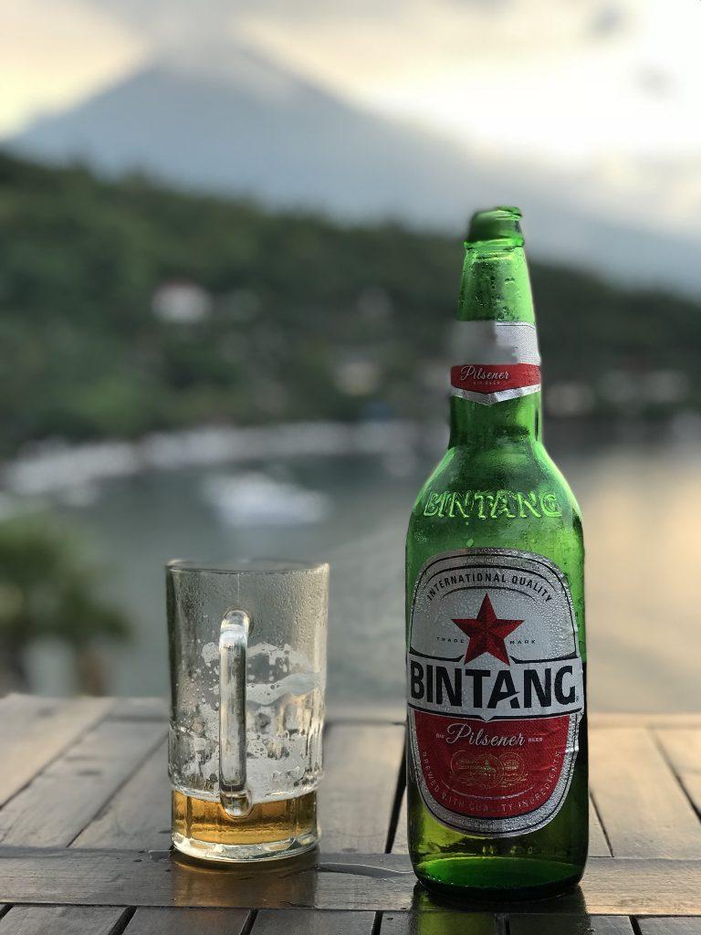 Drinking Bintang beer at sunset View Jemeluk Bay Amed East-Bali